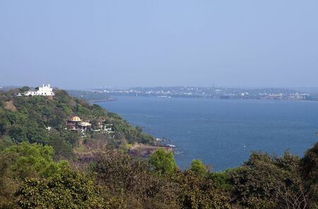 India. Goa View of the sea and the old colonial buildings on the hill