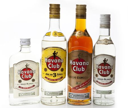 """SAINT-PETERSBURG, RUSSIA- FEBRUARY 16, 2013: different sizes and shapes bottles with white and dark rum """"Havana Club"""", produced in Cuba Editorial"""
