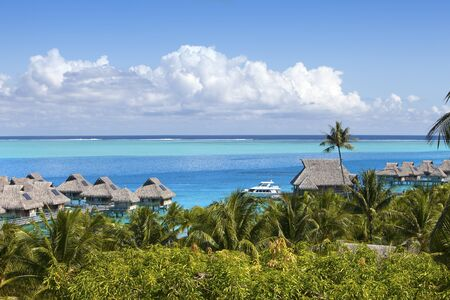 French Polynesia. Over water bungalows and palm trees