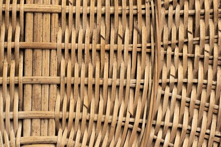 The side of the wicker basket of willow twigs light brown