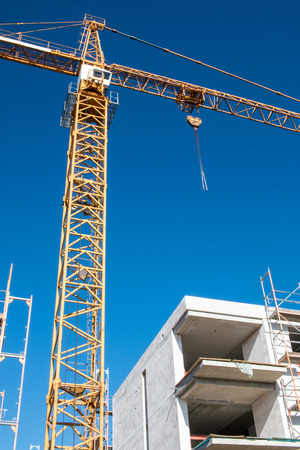 build in: Tall construction crane overtopping a facility in build, shot 2017 Stock Photo