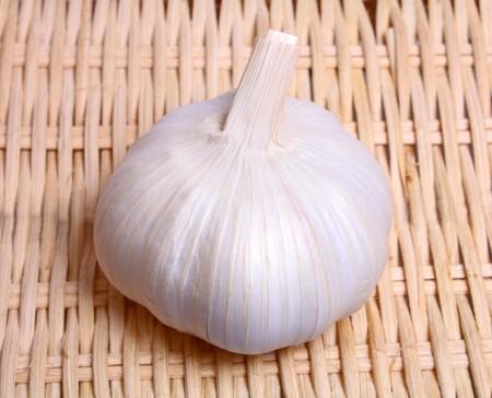 pungent: healthy white vegetable pungent garlic on background