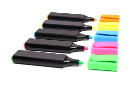 colors plastic markers isolated on white background photo