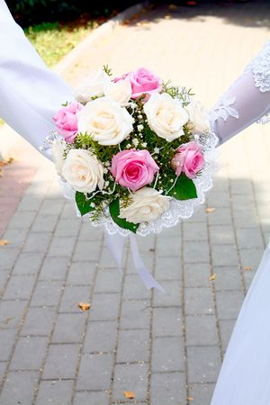 fiancee: wedding bouguet in hands fiance and fiancee