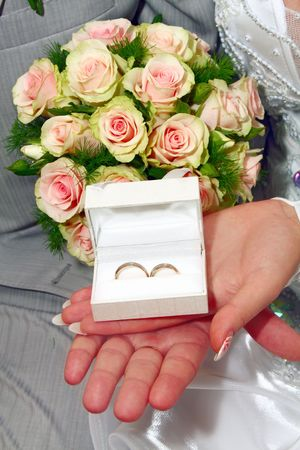 fiancee: two wedding rings in white box and bouquet for fiance and fiancee Stock Photo