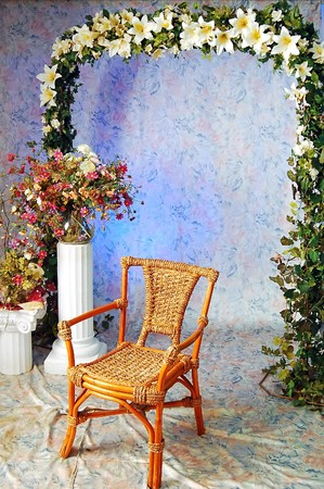 revolved: wooden arm-chair and decorative pattern of flowers