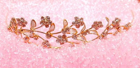 elegance gold diadem on pink background photo