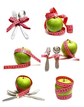 spoon fork and apple is strung by a ribbon for measuring diet isolated on white background photo