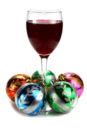 hristmas: glass of red wine and decoration for �hristmas isolated on white background