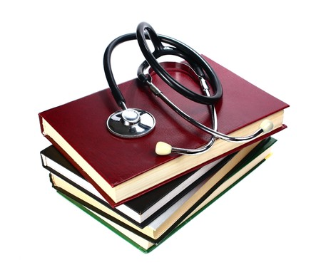 book and stethoscope isolated on white background photo
