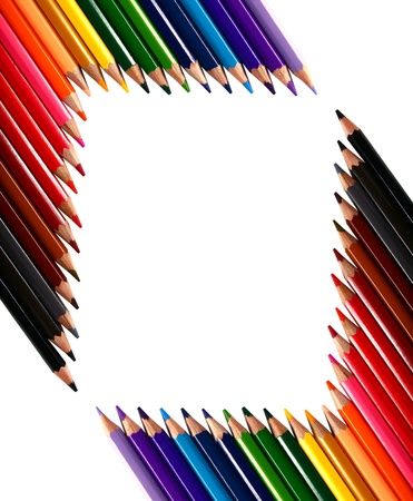 frame made out of crayons coloured pencils isolated on white background photo