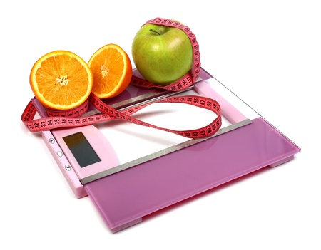 floor scales measuring ribbon apple and orange isolated on white background photo