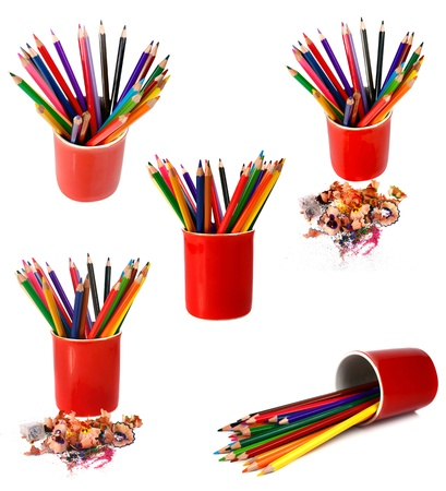 coloured pencils are in red glass isolated on white background photo