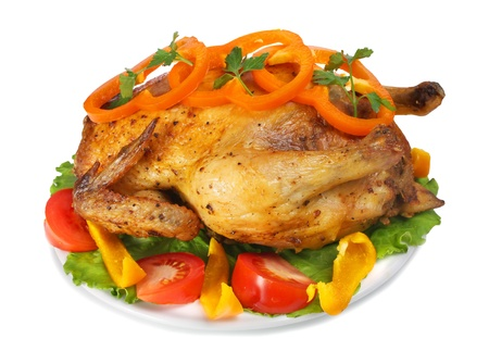 gallina frita con verduras aisladas sobre fondo blanco Foto de archivo