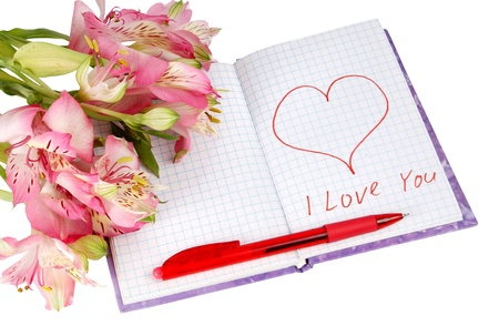 notebook with flowers by a heart and inscription isolated on white background photo