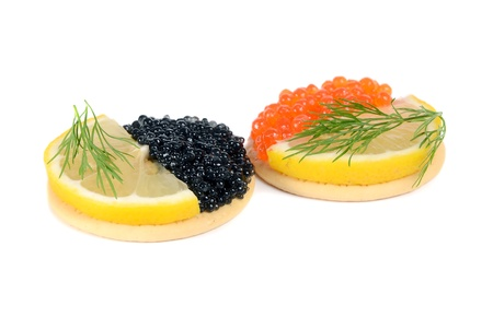 sandwich with black and red caviar isolated on white background photo