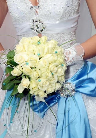 bridal bouquet: bride and wedding bouquet  from white roses