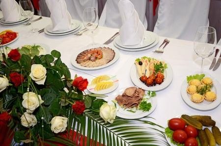 served table with the flowers of roses photo