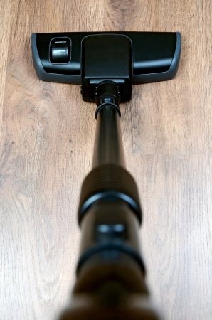 black tube and brush vacuum cleaner photo