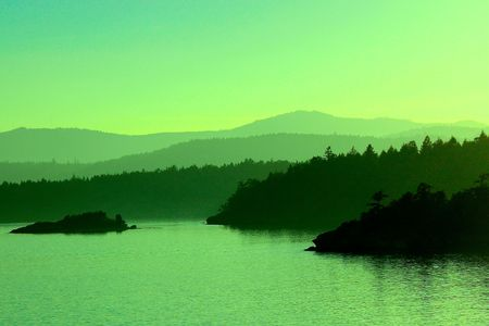 canadian pacific: Green Gulf Islands at Sunset near Vancouver Island, British Columbia, Canada Stock Photo