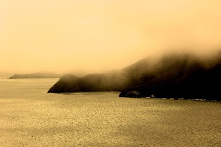 marin: Marin Headlands in Fog Viewed from Golden Gate Bridge Stock Photo