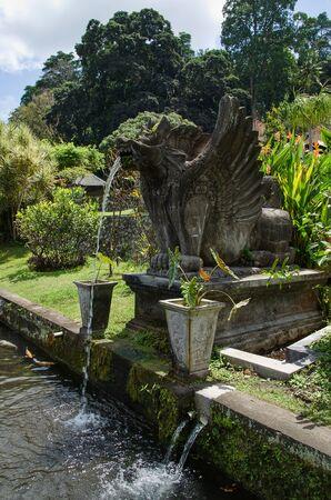 Statue at the Royal Spa in Tirtagangga on Bali Island. Reklamní fotografie
