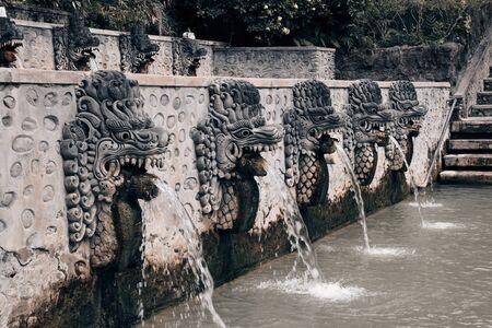 Stone statues spewing sulfuric water in Banjar Hot Springs (Singaraja, Indonesia).