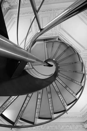 Detail of a spiral staircase made of aluminum and glass.
