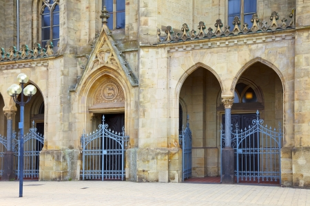 The St. Ludwig Catholic church in city Saarlouis, the entrance with lattice doors, Saarland - Germany Stock Photo