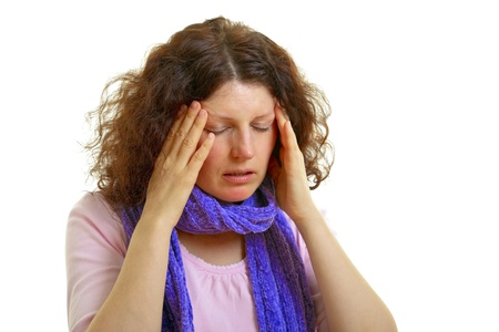 Young brown-haired woman with wool scarf has headache, isolated on white background