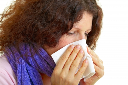 alergy: Young woman with brown hair has a flu