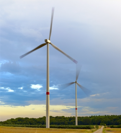 Agriculture landscape with wind turbines, by Beckingen, Saarland - Germany, warm evening sun, stitched - original size   photo