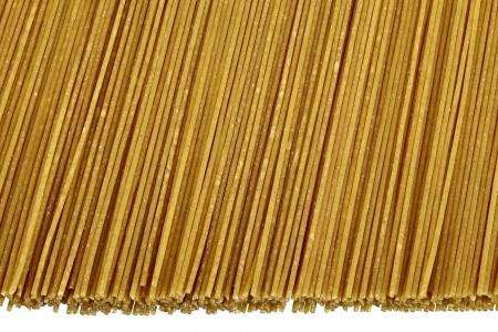 focus stacking: Raw bio whole grain pasta isolated on white background