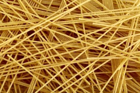 dff image: Raw bio whole grain pasta as food background. DFF image, Adobe RGB Stock Photo