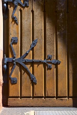 View of the door detail by church in Besseringen, Saarland   Germany, evening sun, summer Stock Photo - 15221530