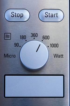 Close up of modern microwave control panel, blue light photo