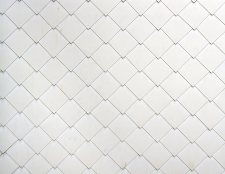 archtecture: View on a wall with asbestos-cement tiles as interesanting archtecture background. Stitched