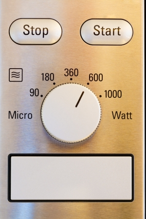 Close up of modern microwave control panel photo