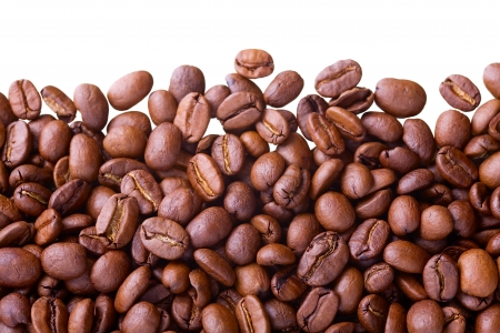 Close up of coffe beans isolated on white(studio shot - not manually isolated), as interesting food background Stock Photo - 16249792