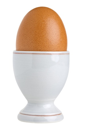 Close up of a eggcup with chicken egg, isolated on white background Stock Photo