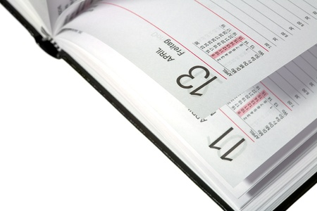 freitag: Close up of a open diary - 13 friday (german - Freitag), isolated on white background