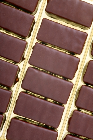 Close up of a chocolates cream-filled in a plastic box photo