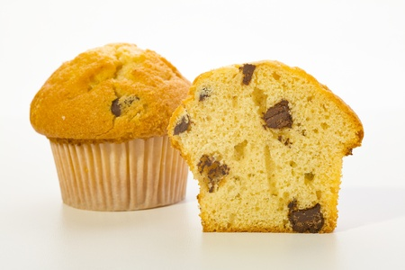 Close up of a muffin cookies with chocolate chips on white background photo