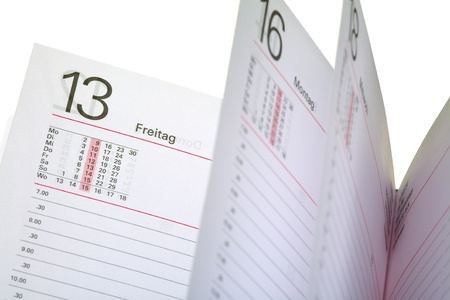 freitag: Close up of a open diary - 13 friday  german - Freitag , isolated on white background