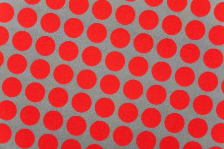 Close up of orange fluorescent dots as interesting background photo