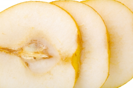 Close up of a pear fruit slices, isolated on white background Stock Photo