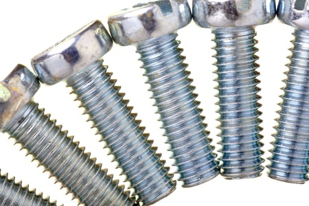 rustproof: Close up of  screws zinc covered, isolated on white background Stock Photo