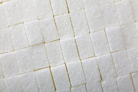 Close up of a sugar cubes as food background photo