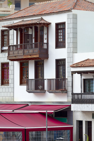 Old historic facade with balcony in Puerto de la Cruz, Tenerife, Canary Islands, Spain. Editorial