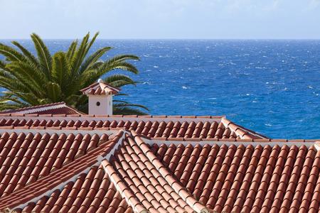 adeje: View of Atlantic over tiled roof, city Costa Adeje, Canatry Islands, Spain.